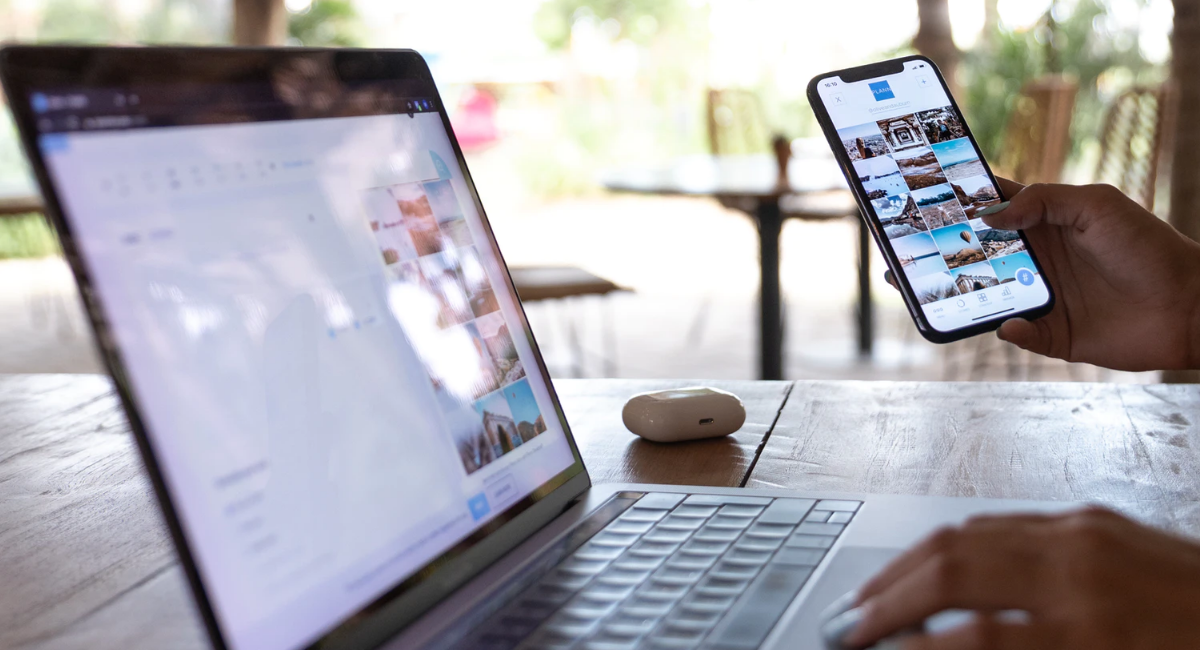 A website opened on both a macbook and smartphone