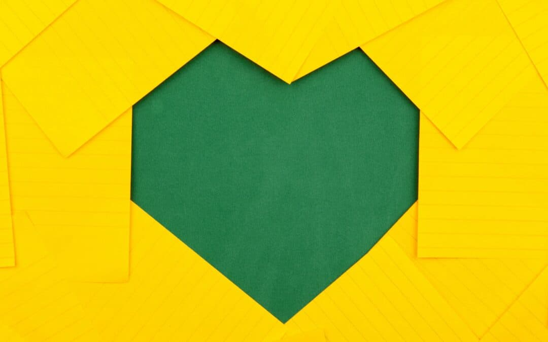 green heart in the middle of yellow wall